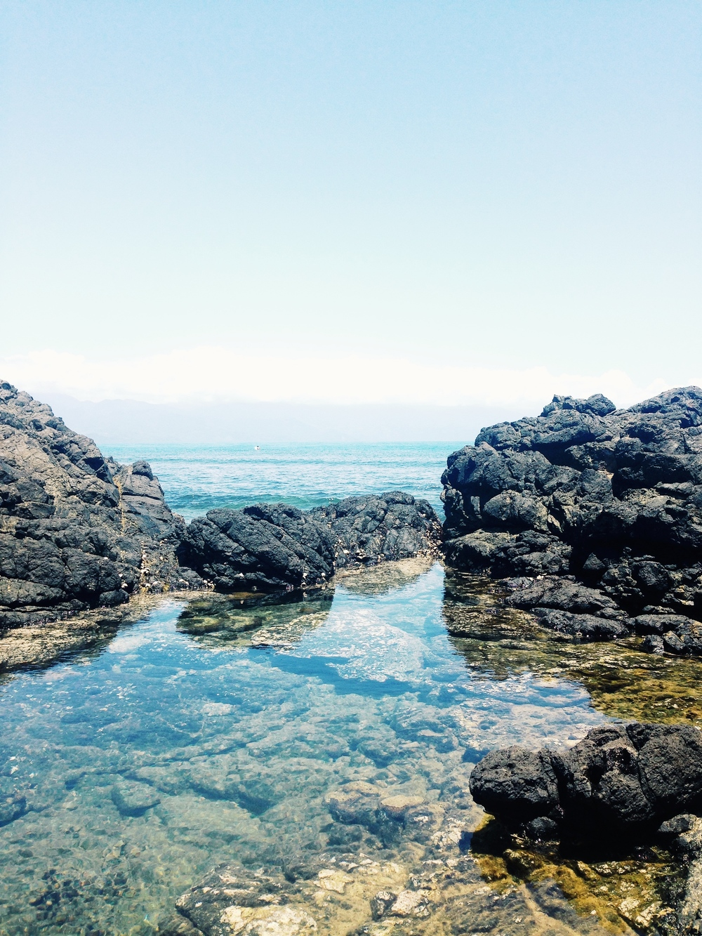 Crystal clear rock pools at Cemento Reef