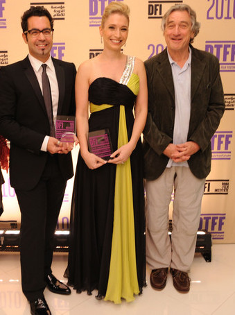 Director Mahmoud Kaabour and executive producer eva sayre receive the audience award from robert de niro