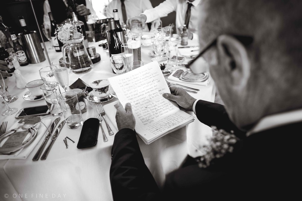 first person documentary perspective photograph of the father of the bride reading through his wedding speech