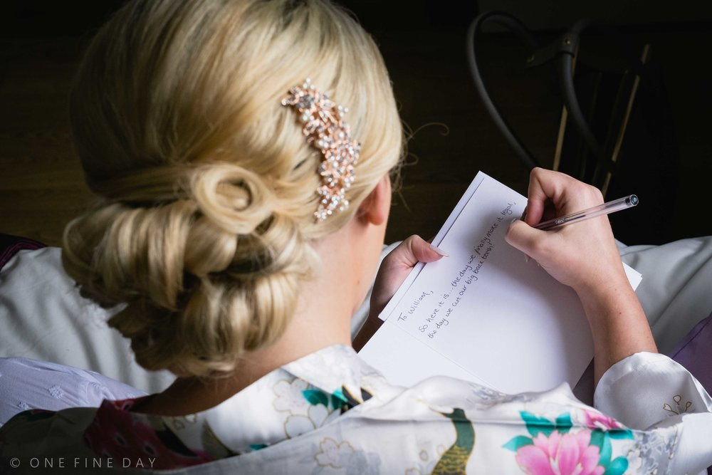 Bride writing a wedding note to her groom