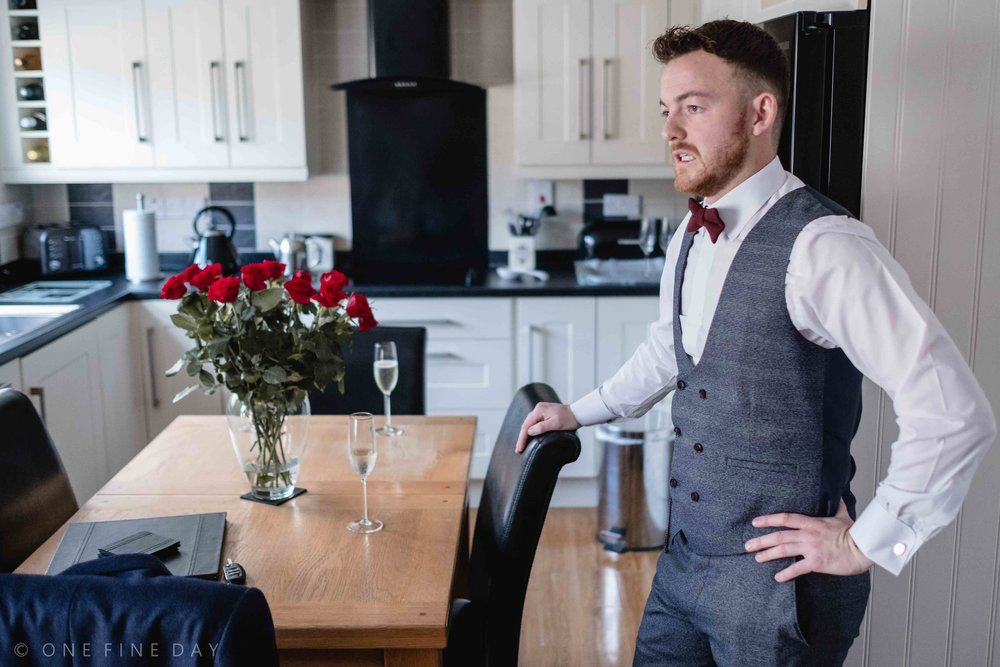 Groom looking nervous on morning of wedding