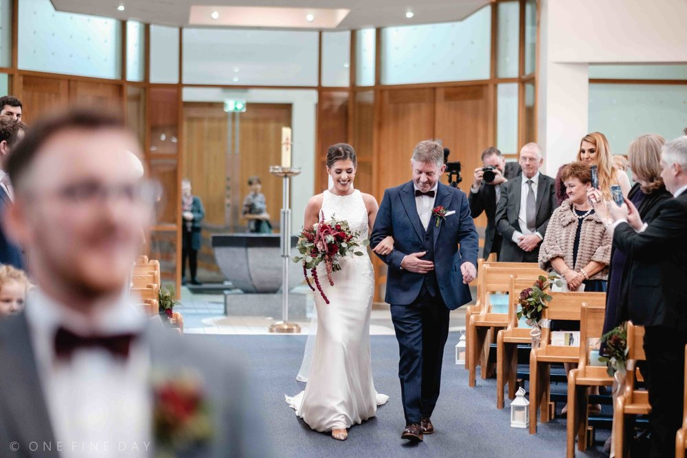 Bride walks down the aisle at wedding in County Antrim Northern Ireland
