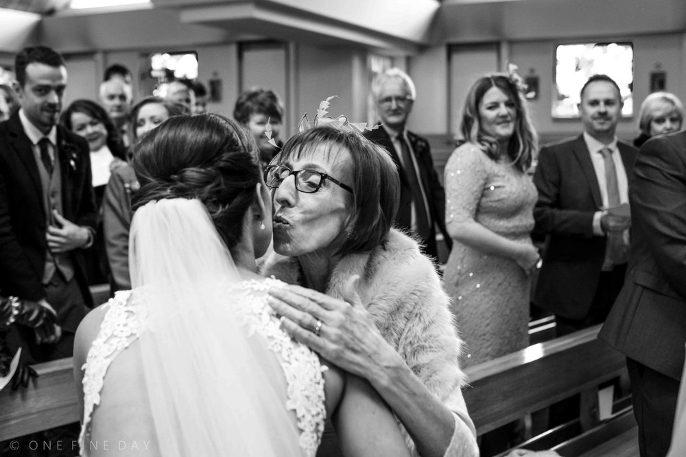 Mother of bride kisses her daughter