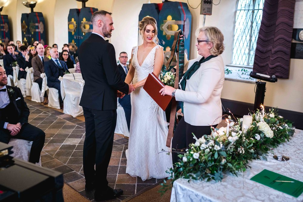 Natural unposed image of wedding ceremony at Carlingford Heritage Centre, Ireland