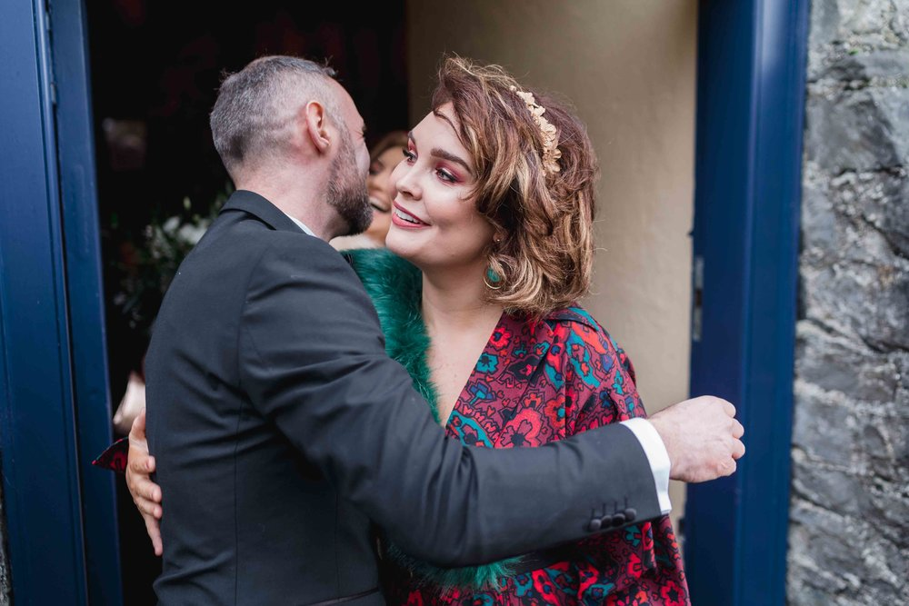 Happiness outside of wedding ceremony Carlingford heritage centre