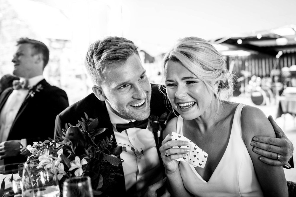 Bride and Groom laughing at their wedding in Northern Ireland
