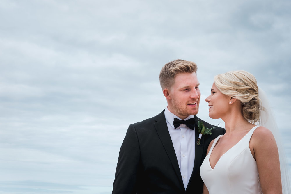 Natural and relaxed wedding portrait of bride and groom on Whiterocks Beach Northern Ireland