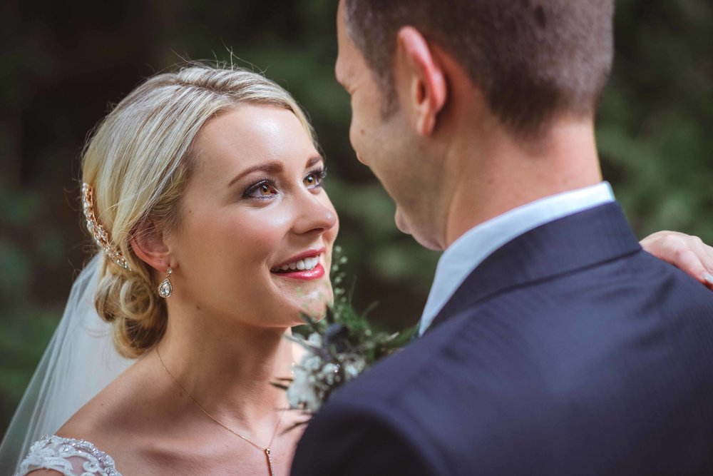 Intimate and natural portrait photograph of bride on her wedding day