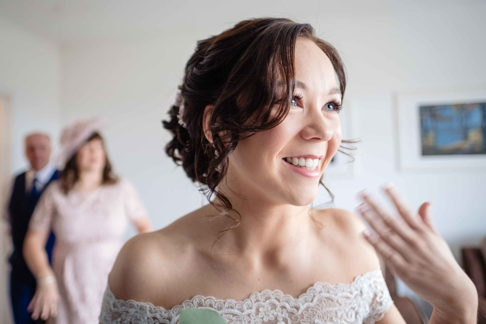 Natural image of nervous bride about to leave for her wedding ceremony in Belfast Northern Ireland