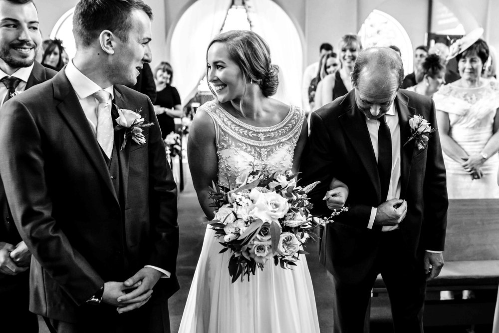 Bride and Groom see each other at the top of the aisle at their wedding ceremony in Northern Ireland