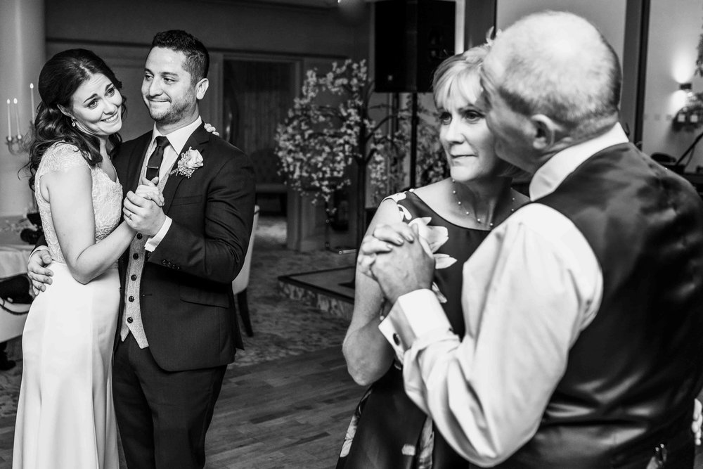 Bride and Groom and Bride's Parents Dance at their wedding in Northern Ireland