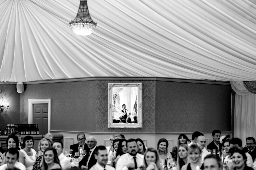 Groom Reflected in a mirror during his wedding speech at Ballyscullion Park Northern Ireland