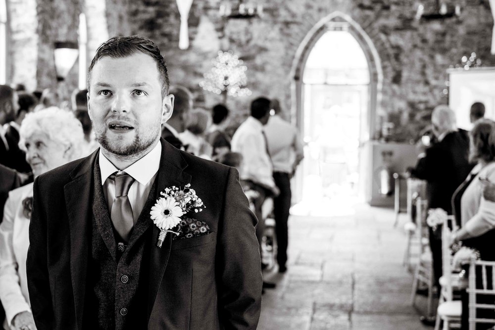 Natural image of the nervous groom at the top of the aisle at Orange Tree House Northern Ireland