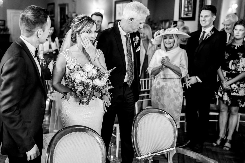 Natural photograph of the emotional bride during wedding ceremony, Tinakilly House, Wicklow, Ireland