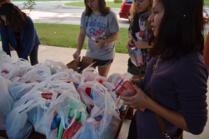 UNC students filling bags of toiletries to be delivered to farmworker camps