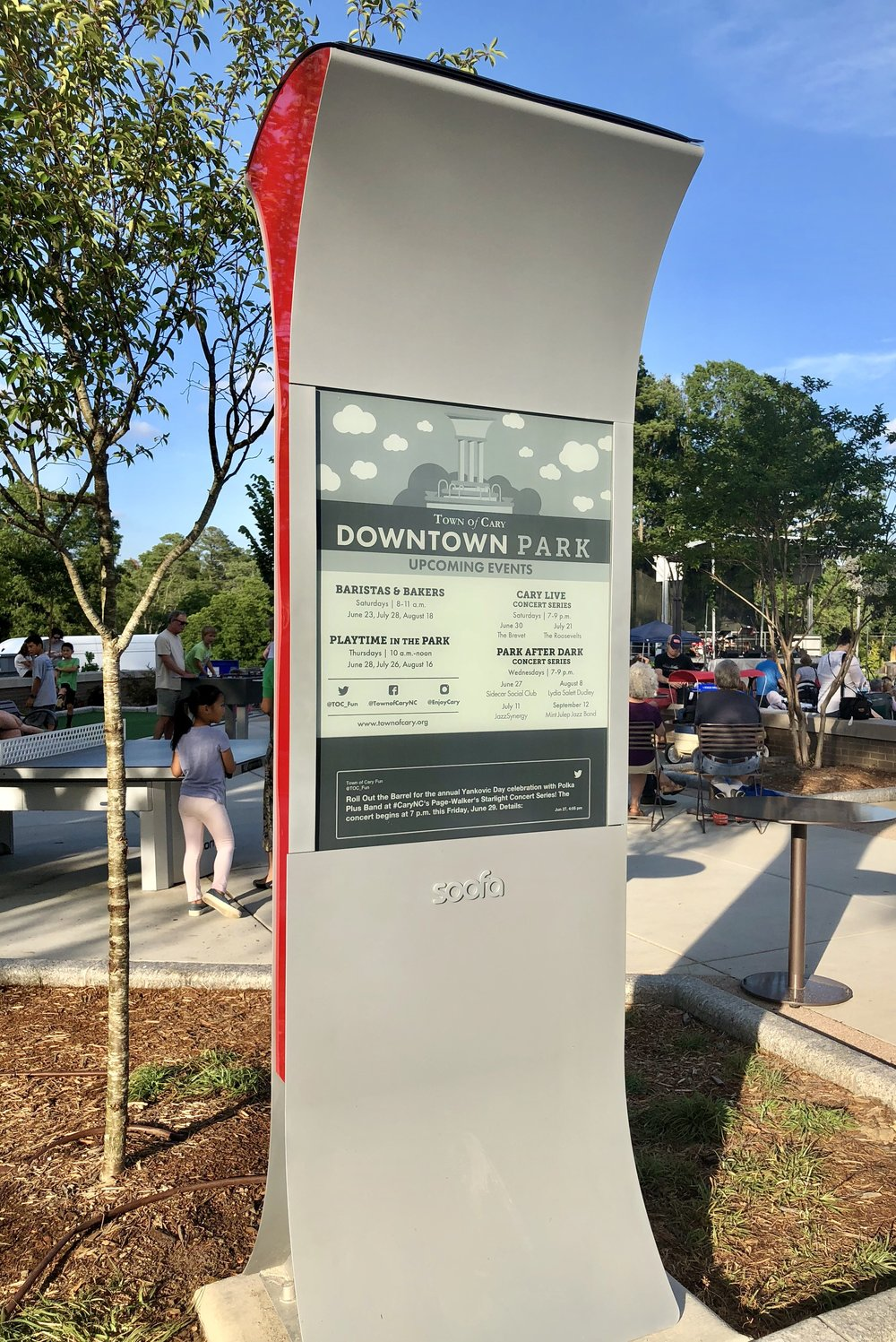 A newly-installed Soofa Sign advertises upcoming events in Cary's downtown park.