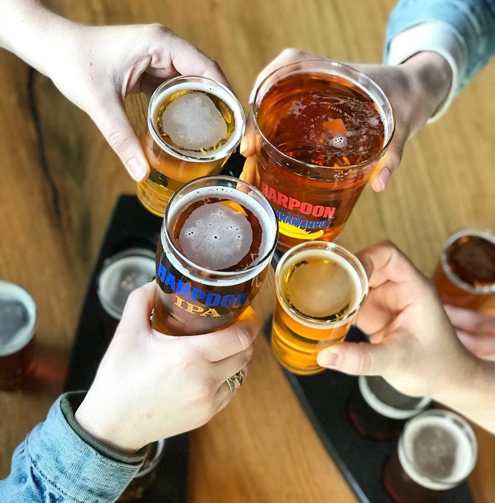 Four friends toast with Harpoon brews. From the  Harpoon Instagram .