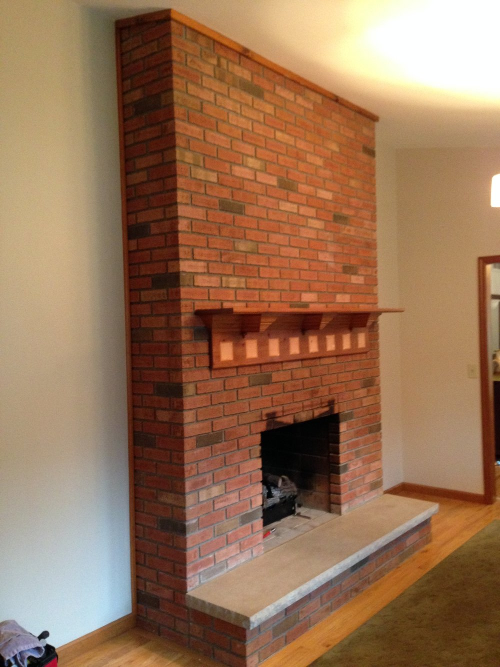 Updated this large two sided brick fireplace in Latham