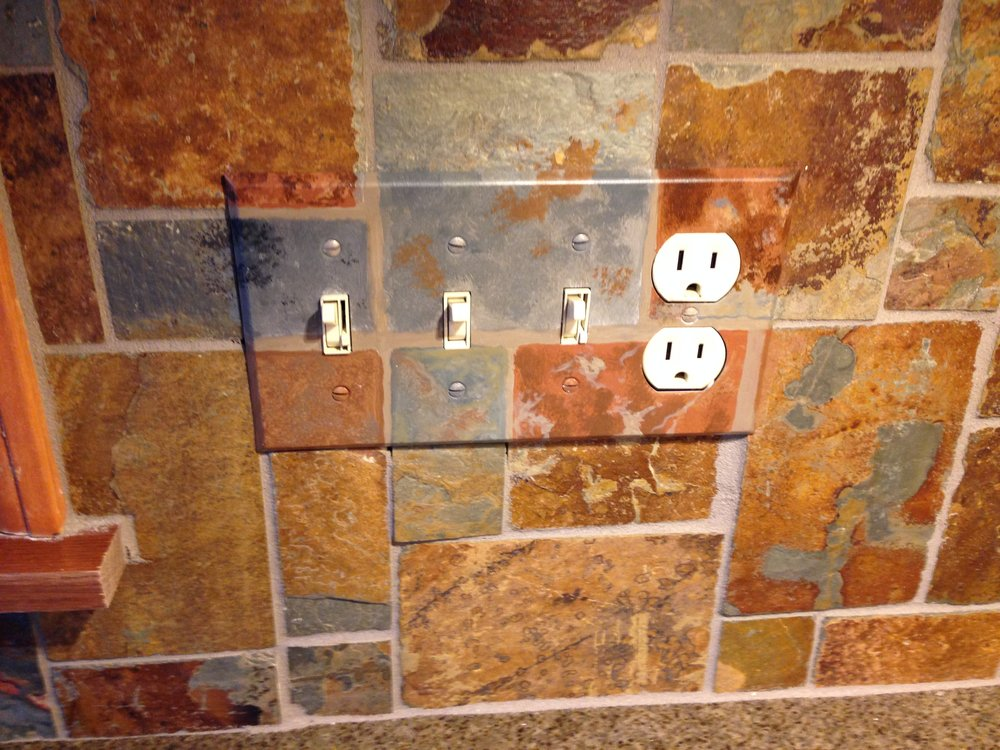 The homeowners of this Loudonville kitchen  LOVE their hand painted switch plate covers!
