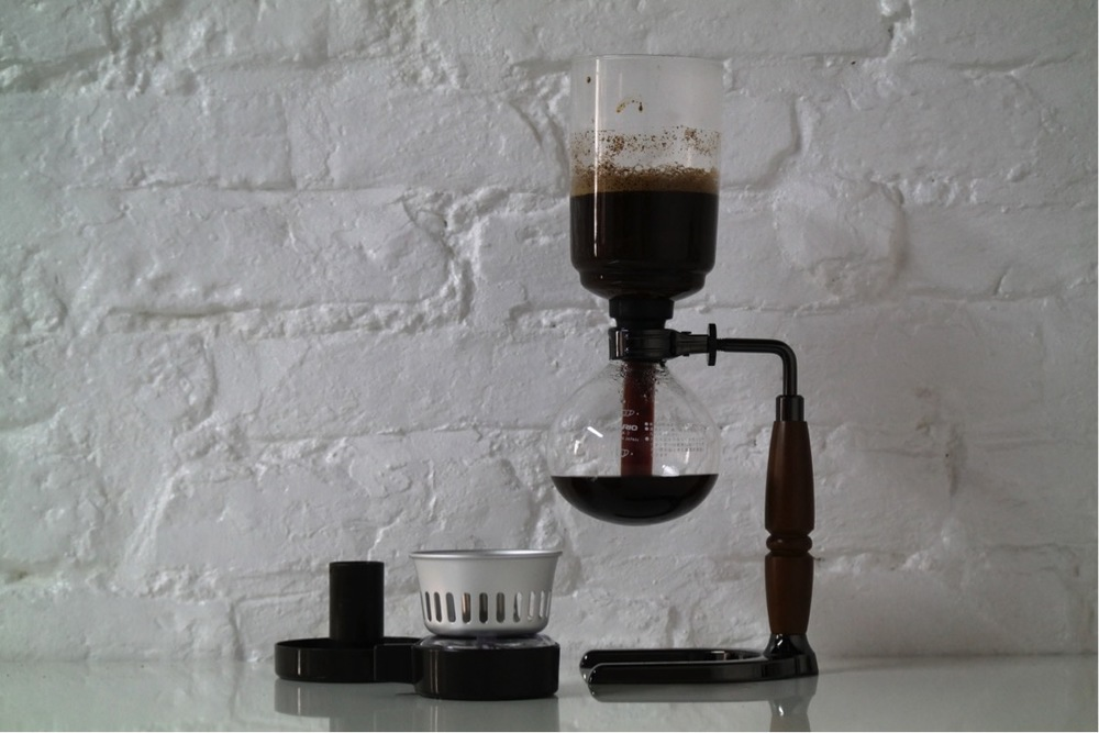 "Normal.dotm   0   0   1   24   139   Gorilla Grafiks   1   1   170   12.0                      0   false       18 pt   18 pt   0   0     false   false   false                                       /* Style Definitions */ table.MsoNormalTable 	{mso-style-name:""Table Normal""; 	mso-tstyle-rowband-size:0; 	mso-tstyle-colband-size:0; 	mso-style-noshow:yes; 	mso-style-parent:""""; 	mso-padding-alt:0cm 5.4pt 0cm 5.4pt; 	mso-para-margin:0cm; 	mso-para-margin-bottom:.0001pt; 	mso-pagination:widow-orphan; 	font-size:12.0pt; 	font-family:""Times New Roman""; 	mso-ascii-font-family:Cambria; 	mso-ascii-theme-font:minor-latin; 	mso-fareast-font-family:""Times New Roman""; 	mso-fareast-theme-font:minor-fareast; 	mso-hansi-font-family:Cambria; 	mso-hansi-theme-font:minor-latin; 	mso-ansi-language:EN-US;}     Remove the burner and use the metal cap supplied to put out the flame.  The coffee will now be sucked into the lower bowl leaving the coffee grounds in the upper bowl."