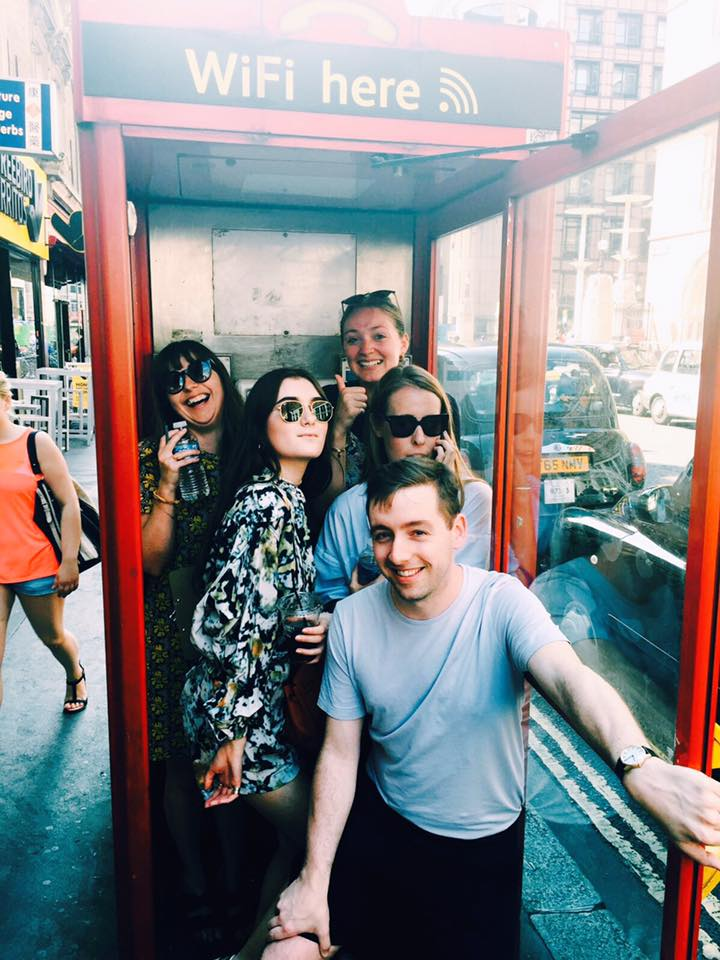 Challenge: Photo of all team members in a phone box
