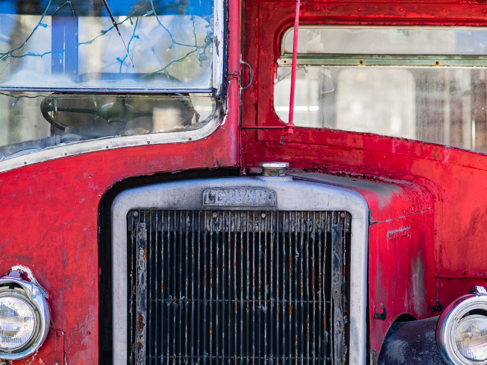 "This challenge was about ""transportation."" This is a decrepit double-decker bus parked in front of an ""olde English pub"" near my home. I shot this with the intent of making a composite image, but when it came time to edit I actually preferred this tight, flattened, and almost abstract version.    Copyright 2016 Hannah C. Nesbeda. All rights reserved."