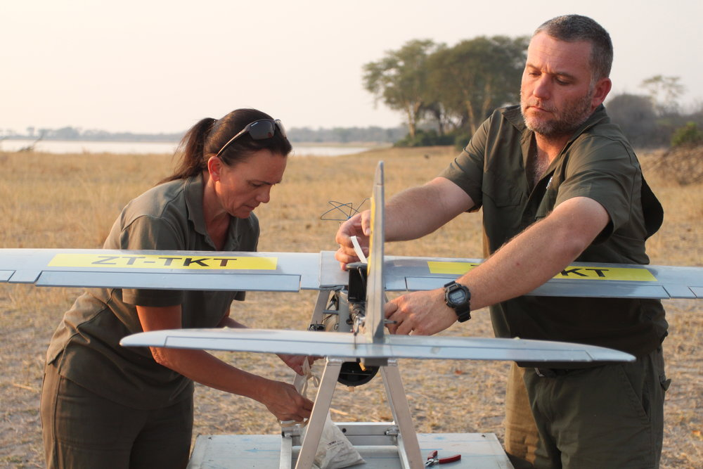 Antoinette Dudley and Stephan De Necker assemble a UDS BatHawk drone at Liwonde National Park.