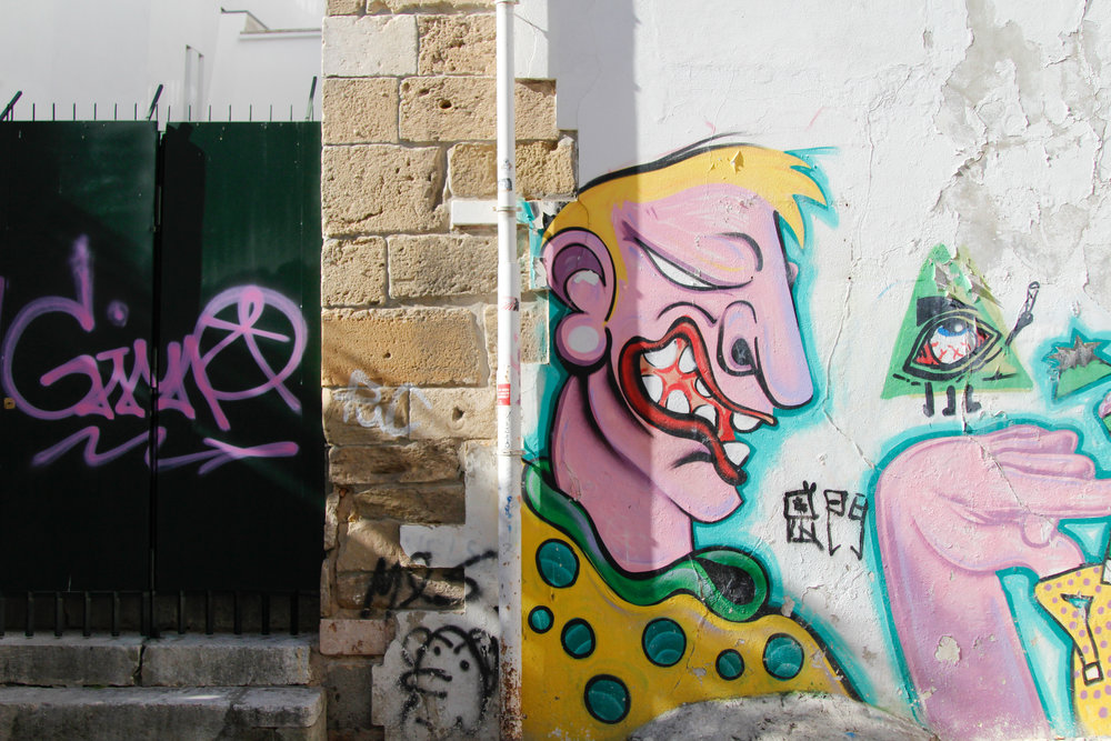 Graffiti along the steps to the castle in Lisbon