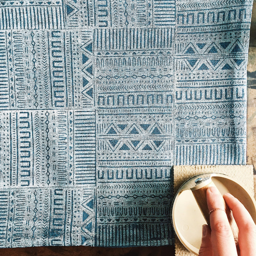 Block printing a pillow cover textile.