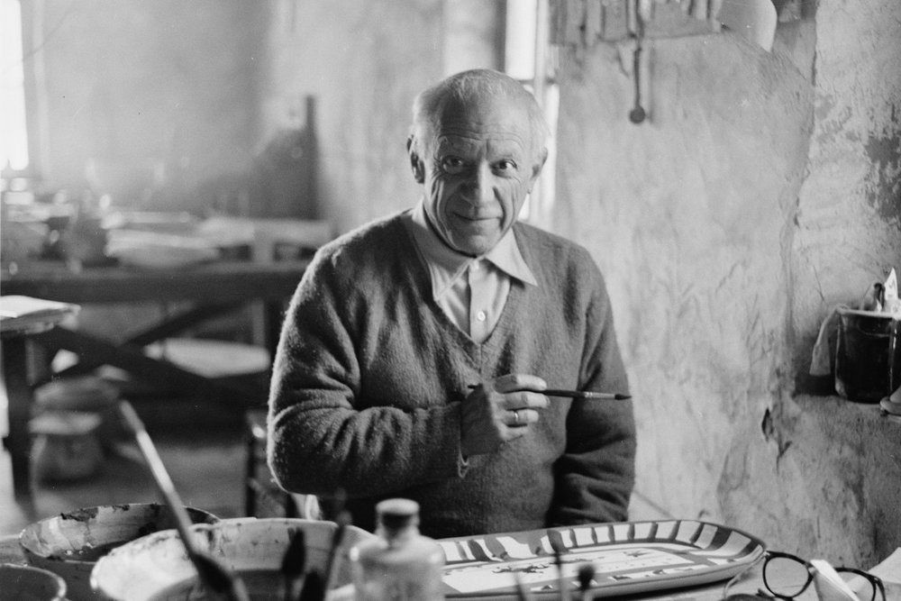 """Pablo-Picasso-works-on-the-plate-""""Picador-et-torrero""""-at-the-Madoura-pottery-in-Vallauris-Photo-by-Edward-Quinn.jpg"""