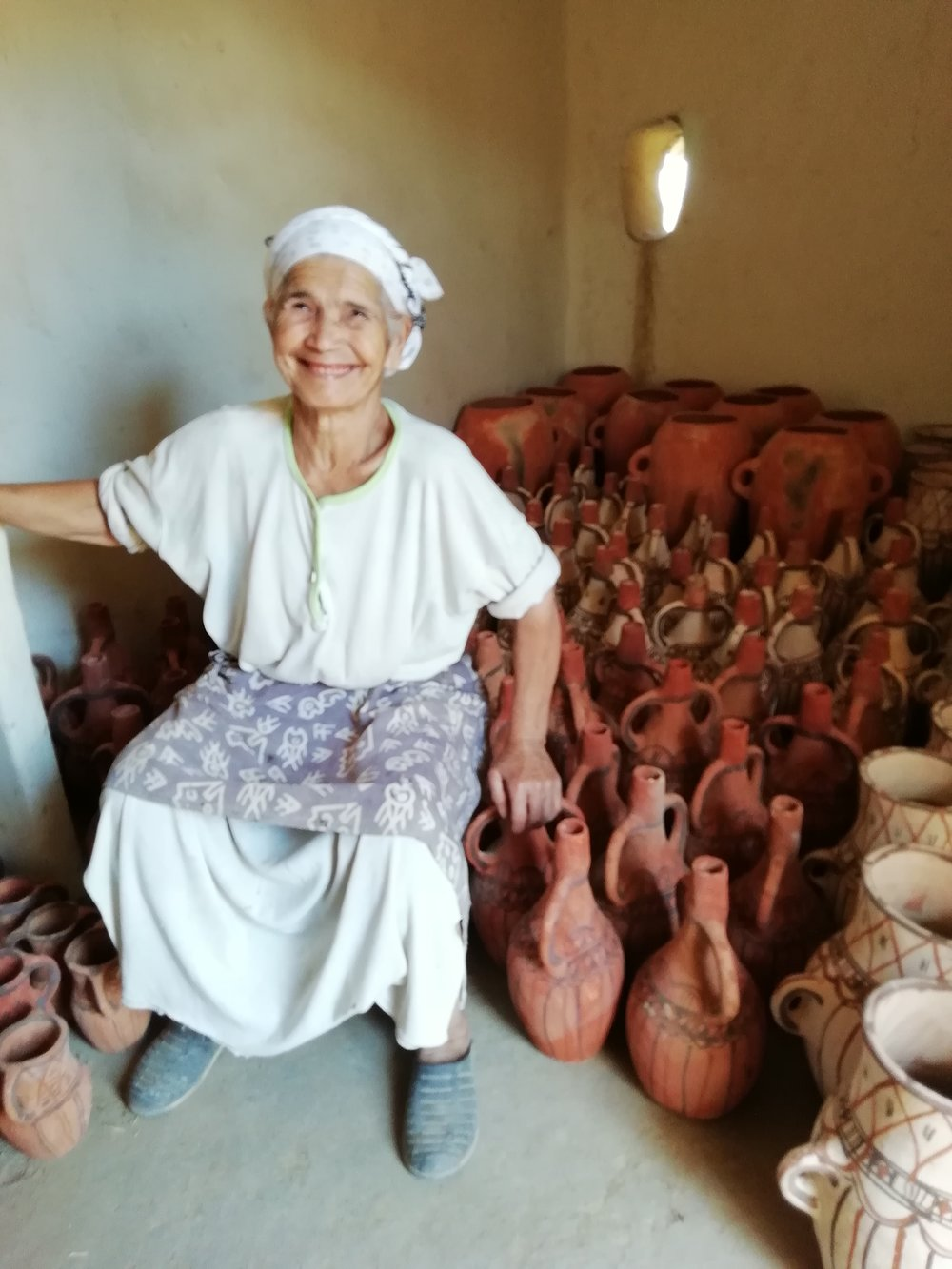 My new idol - Mama Aicha sat on a barn full of her beautiful ceramics - Ready to be exported by the Sumano Organisation.