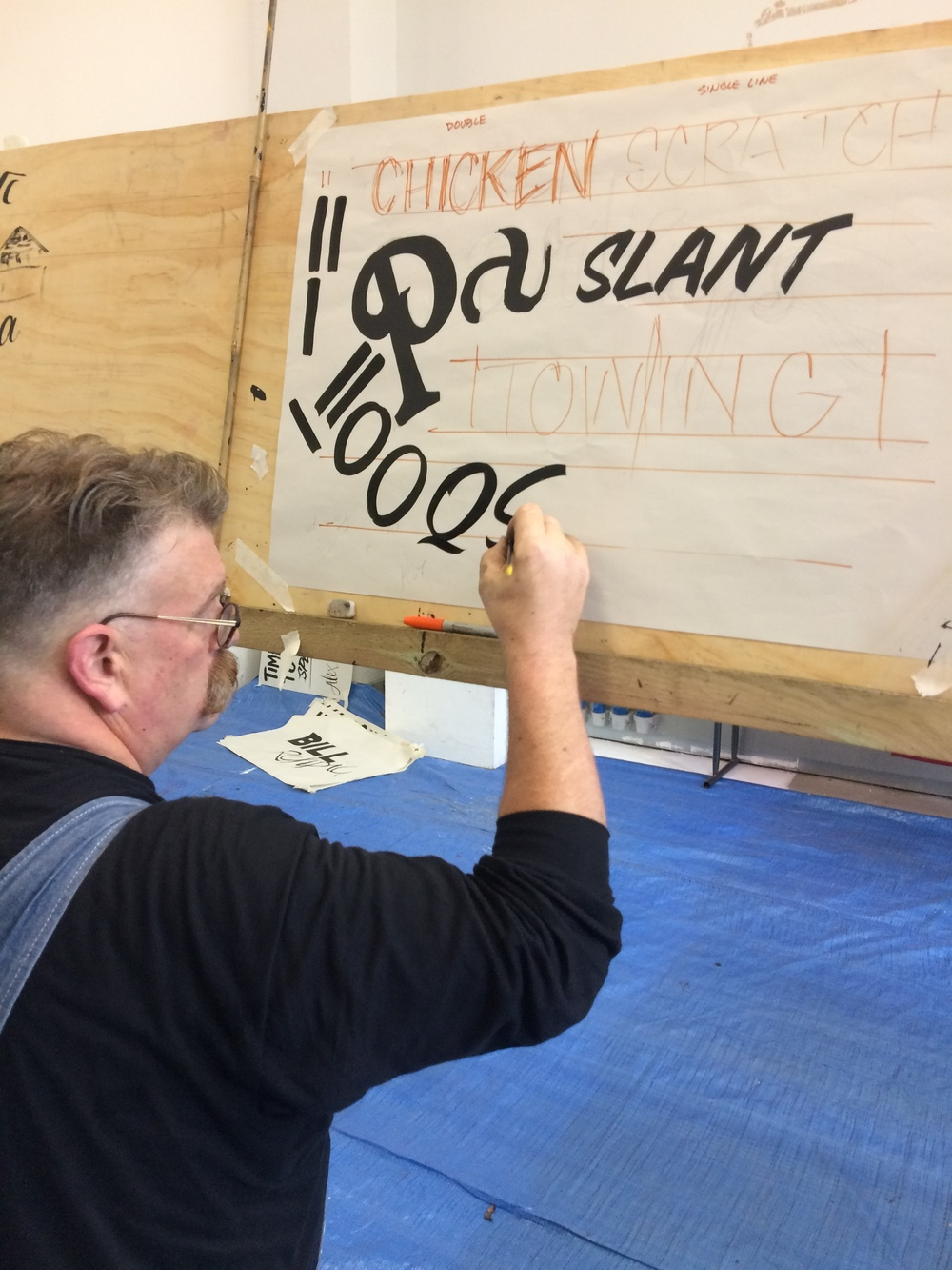 Mike demonstrating slanted casual lettering over some of my rough scribbles