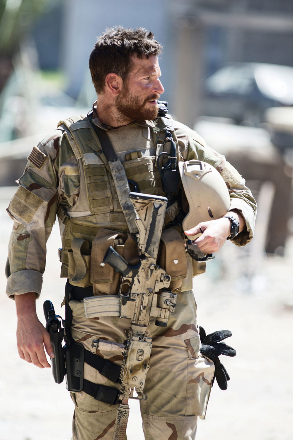 A beefed up Bradley Cooper as Chris Kyle, America's deadliest sniper, in Clint Eastwood's blockbuster homage to the warrior ethos, American Sniper (2014).