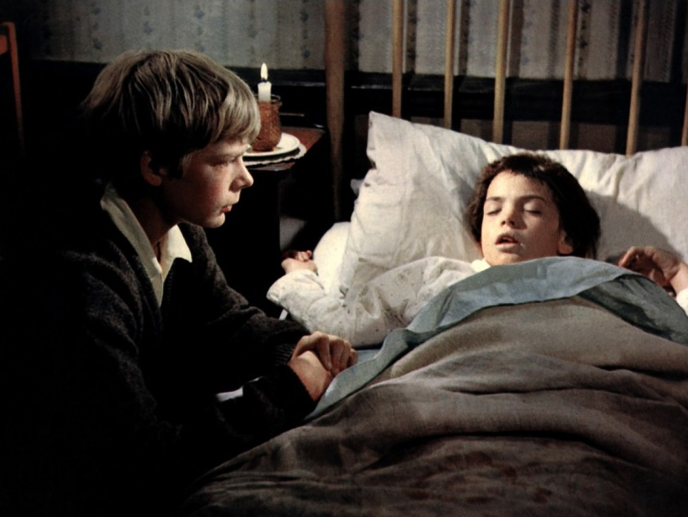 Hubert (Louis Sheldon Williams) comforts his ailing sister Gerty (Sarah Nicholls).