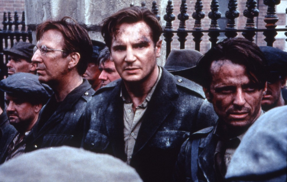 From left to right, Eamon de Valera (Alan Rickman), Michael Collins (Liam Neeson), and Harry Boland (Aidan Quinn) are arrested after the failure of the Easter Rising.