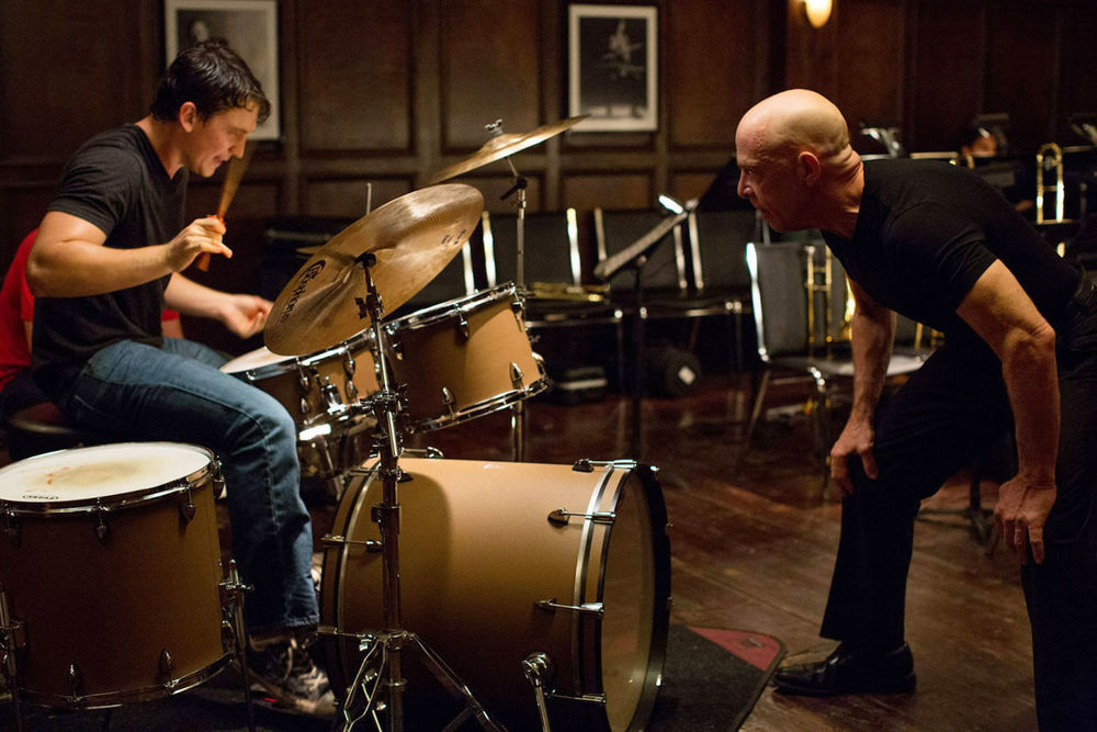The two protagonists of Whiplash, Andrew (Miles Teller) and Fletcher (J. K. Simmons)