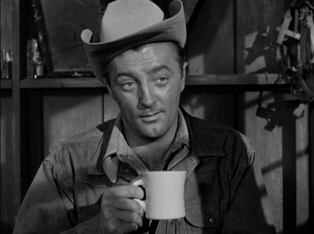 Robert Mitchum as former rodeo champ Jeff McCloud