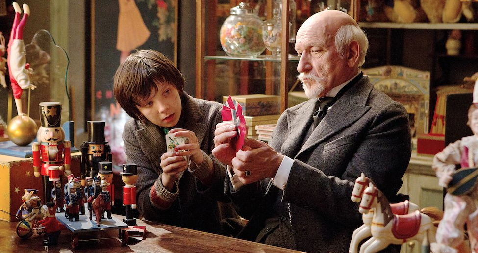 Ben Kingsley as Georges Méliès and   Asa Butterfield as Hugo Cabret in  Hugo