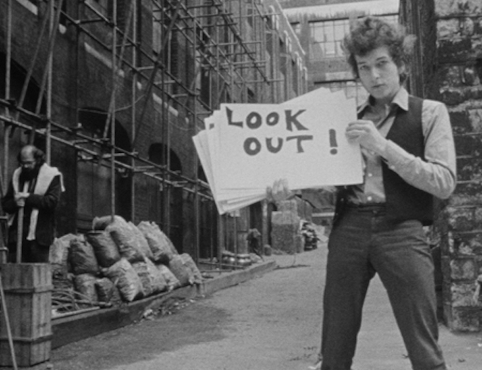 Bob Dylan, with Allen Ginsberg in the background, from Don't Look Back's famous opening