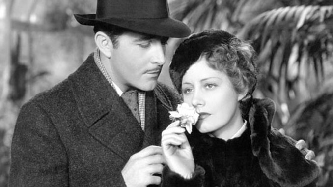 John Boles as Newland Archer and Irene Dunne as Ellen Olenska
