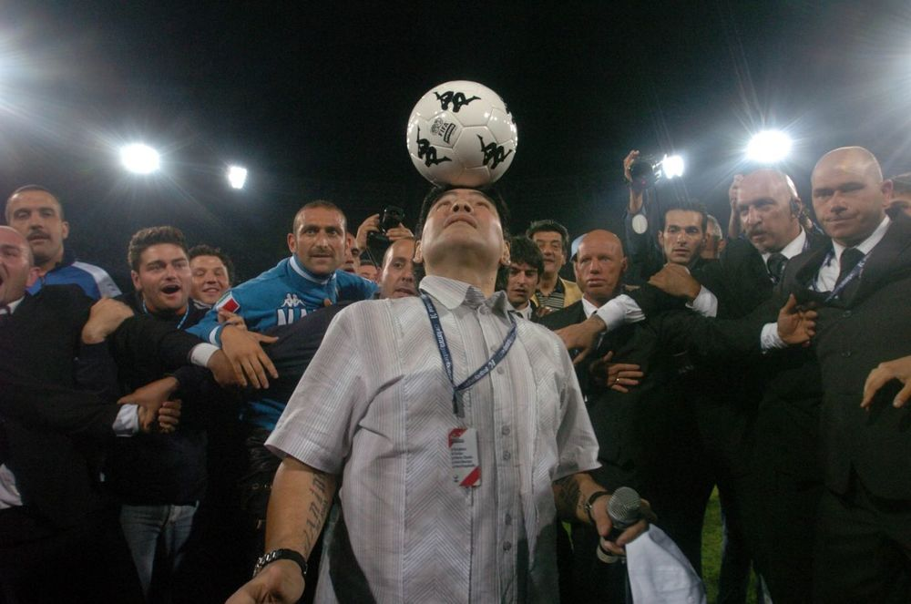Soccer great Diego Maradona playing up to the Press in Emir Kusturica's Maradona by Kusturica