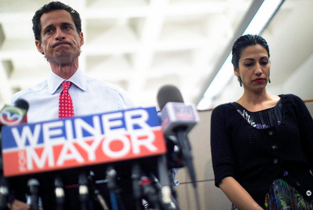 A chastened Anthony Weiner and his humiliated but surprisingly still supportive wife Uma Abedin appear at a press conference.