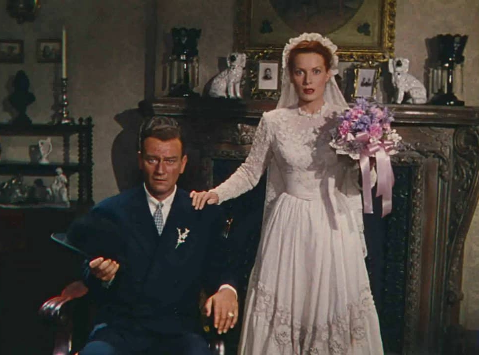 Sean Thornton (John Wayne) and Mary Kate Danaher (Maureen O'Hara) pose for a wedding photo  .