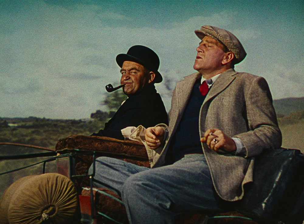 Michaeleen Oge Flynn (Barry Fitzgerald) and Sean Thornton (John Wayne)  .