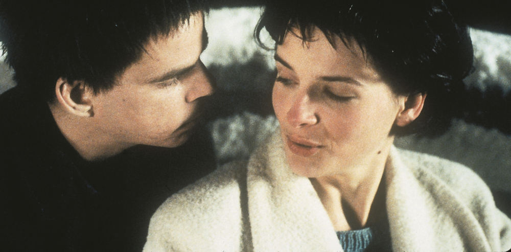 Denis Lavant and Juliette Binoche as Alex and Michèle.