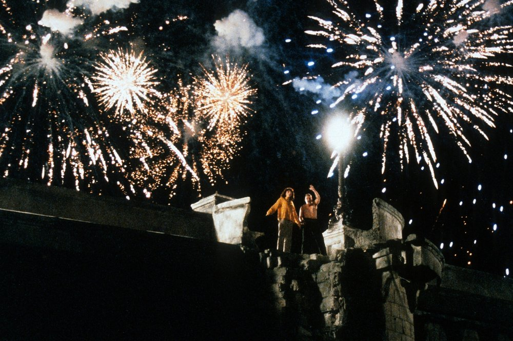 In the film's spectacular set piece, Alex and Michèle exult in the fireworks display celebrating the bicentennial  of the French Revolution.