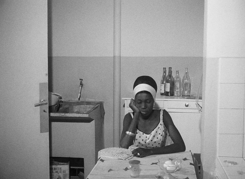 M'bissine Therese Diop as Diouana, imprisoned in Madame's apartment.