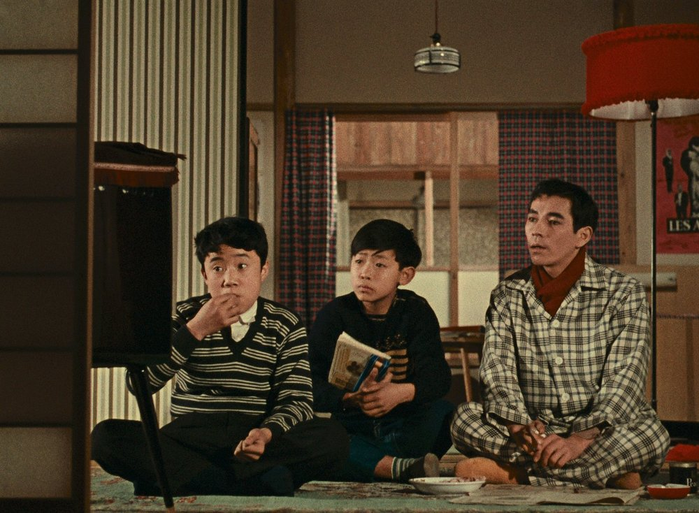 The new TV set owned by a neighbor becomes a local attraction for local schoolboys in Yasujiro Ozu's  Good Morning .