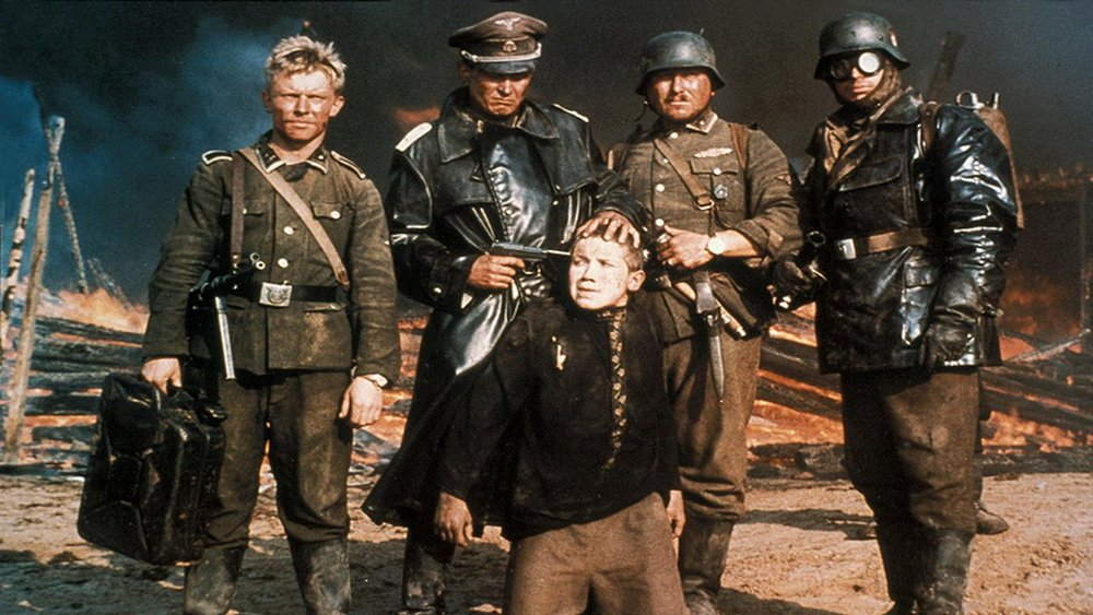 The young partisan Florya (Aleksei Kravchenko) forced at gunpoint for a photo by the German invaders in Elem Klimov's searing Come and See.