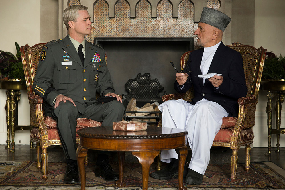 "General Glen McMahon (Brad Pitt) explains to the Afghan President (Ben Kingsley) the U.S. military's planned ""new direction"" for the conflict in his country."